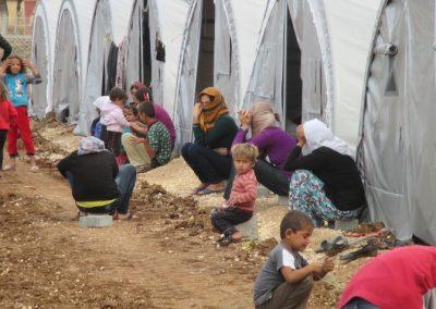 older-women-and-children-in-camp